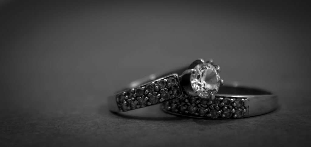grayscale-photo-of-2-silver-with-diamond-rings-168927