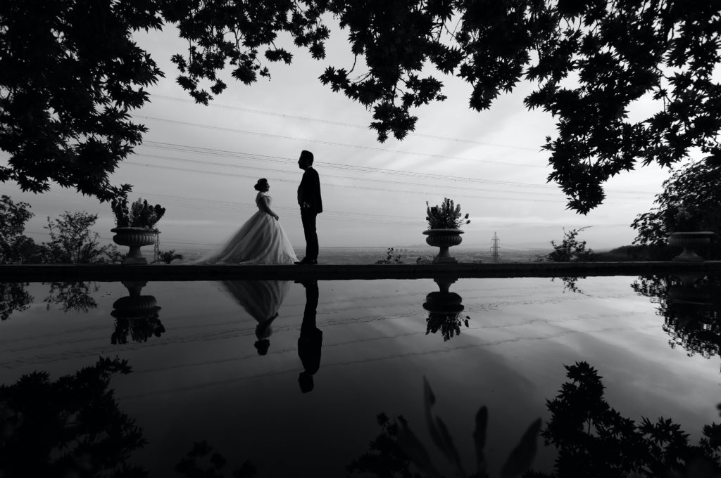 grayscale-photo-of-bride-and-groom-facing-each-other-2909476