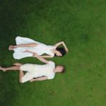happy-couple-resting-on-green-grass-4172929