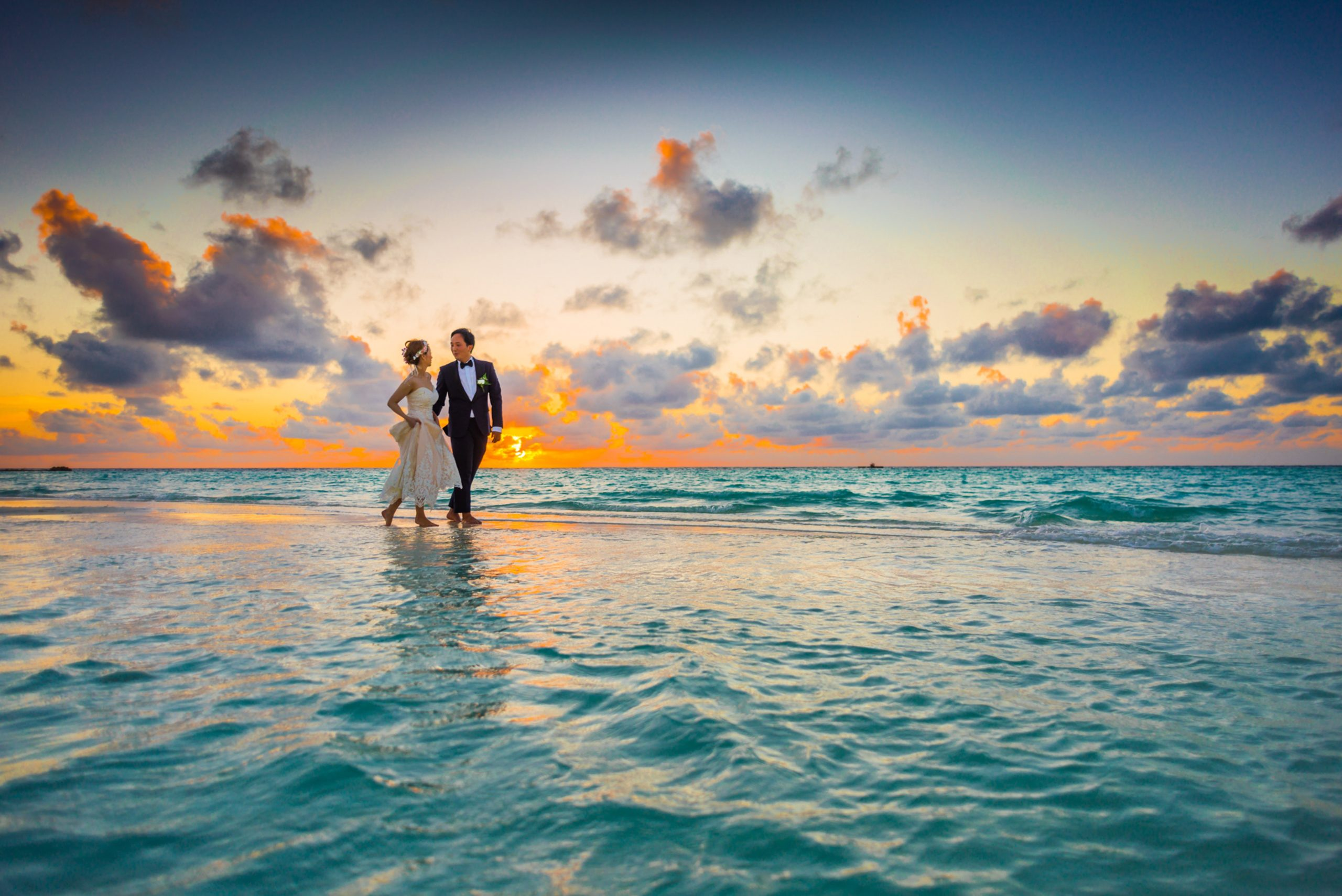 man-and-woman-walking-of-body-of-water-1024993