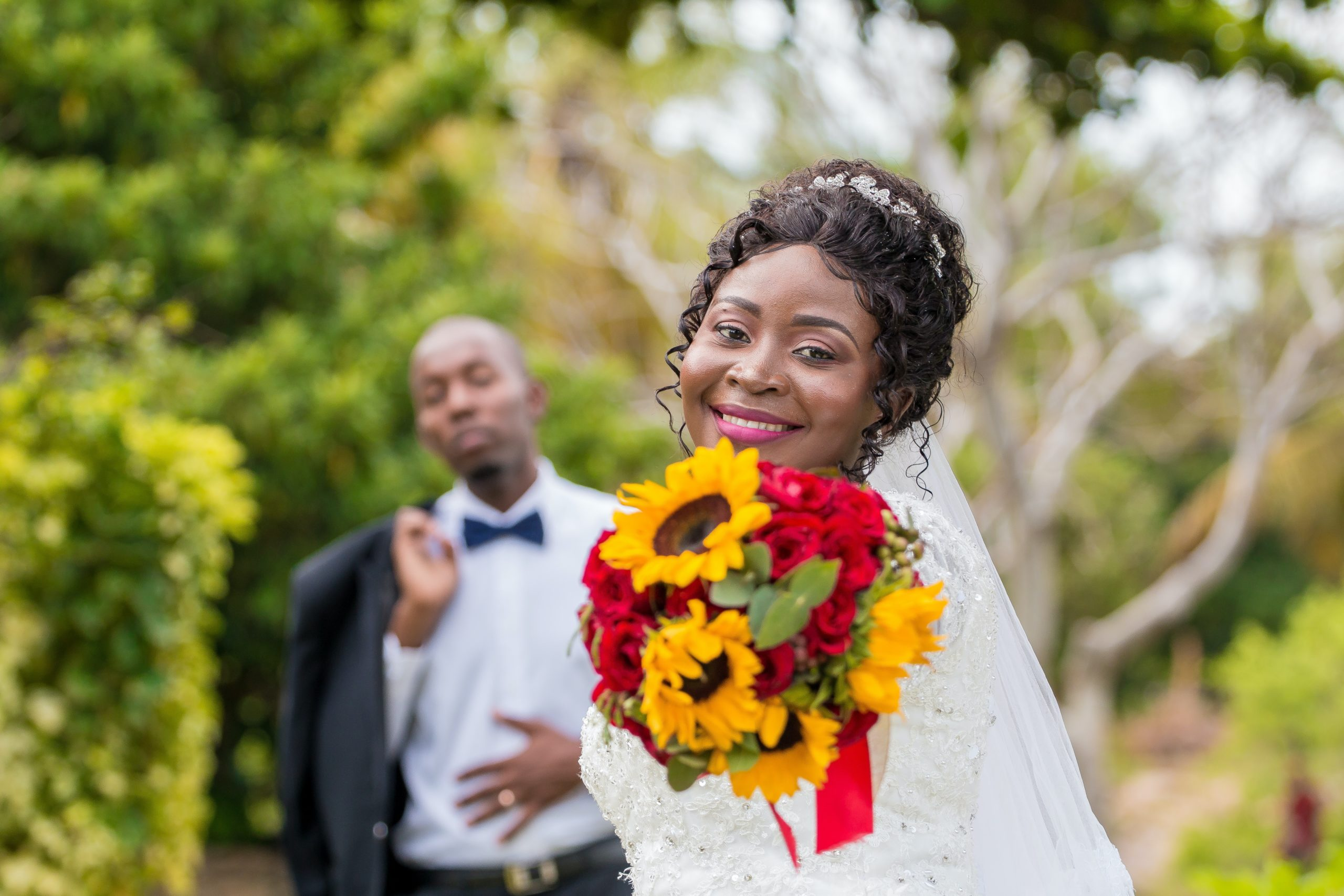 photo-of-woman-holding-bouquet-of-flowers-3657595