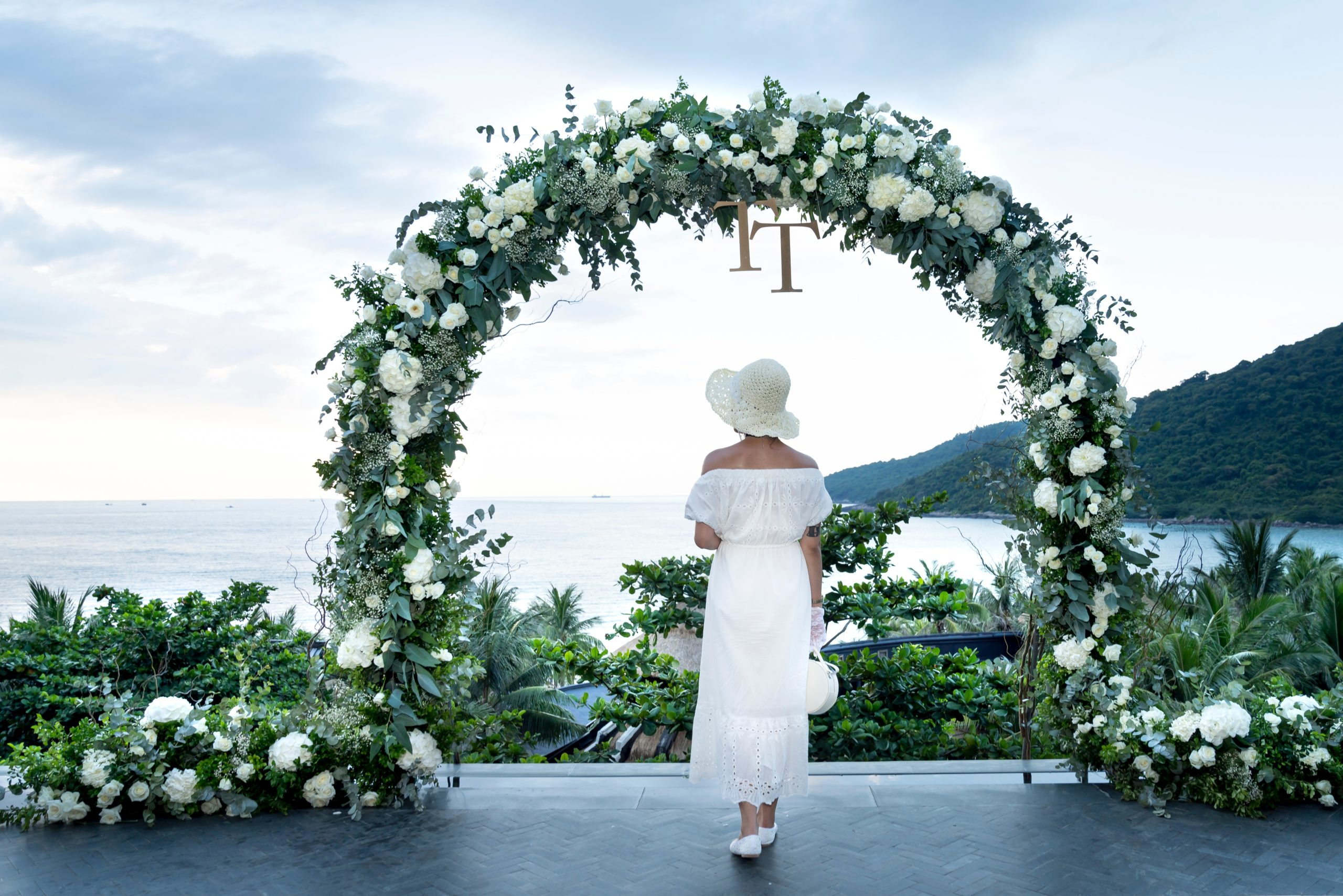 photo-of-woman-wearing-white-dress-near-flower-arbor-2476636