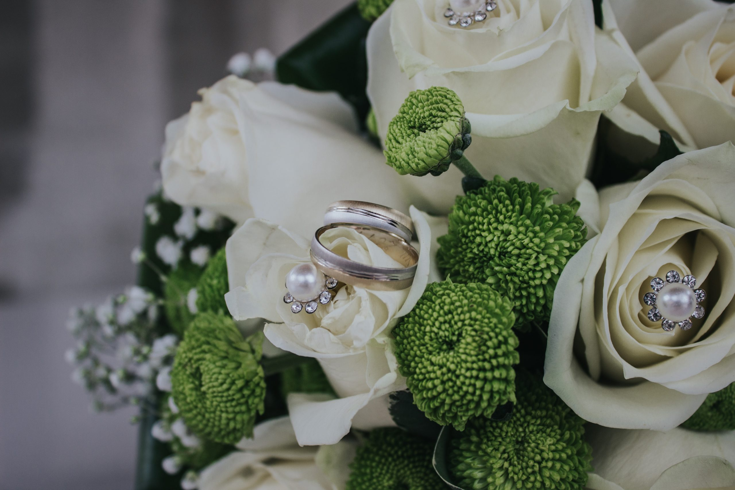 red-and-green-petaled-flowers-bouquet-with-silver-colored-948189