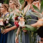 selective-focus-photography-of-women-holding-wedding-flowers-3585806