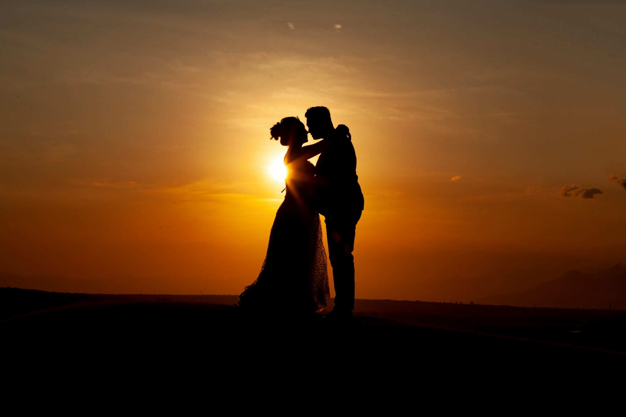 silhouette-of-couple-kissing-during-sunset-3998366