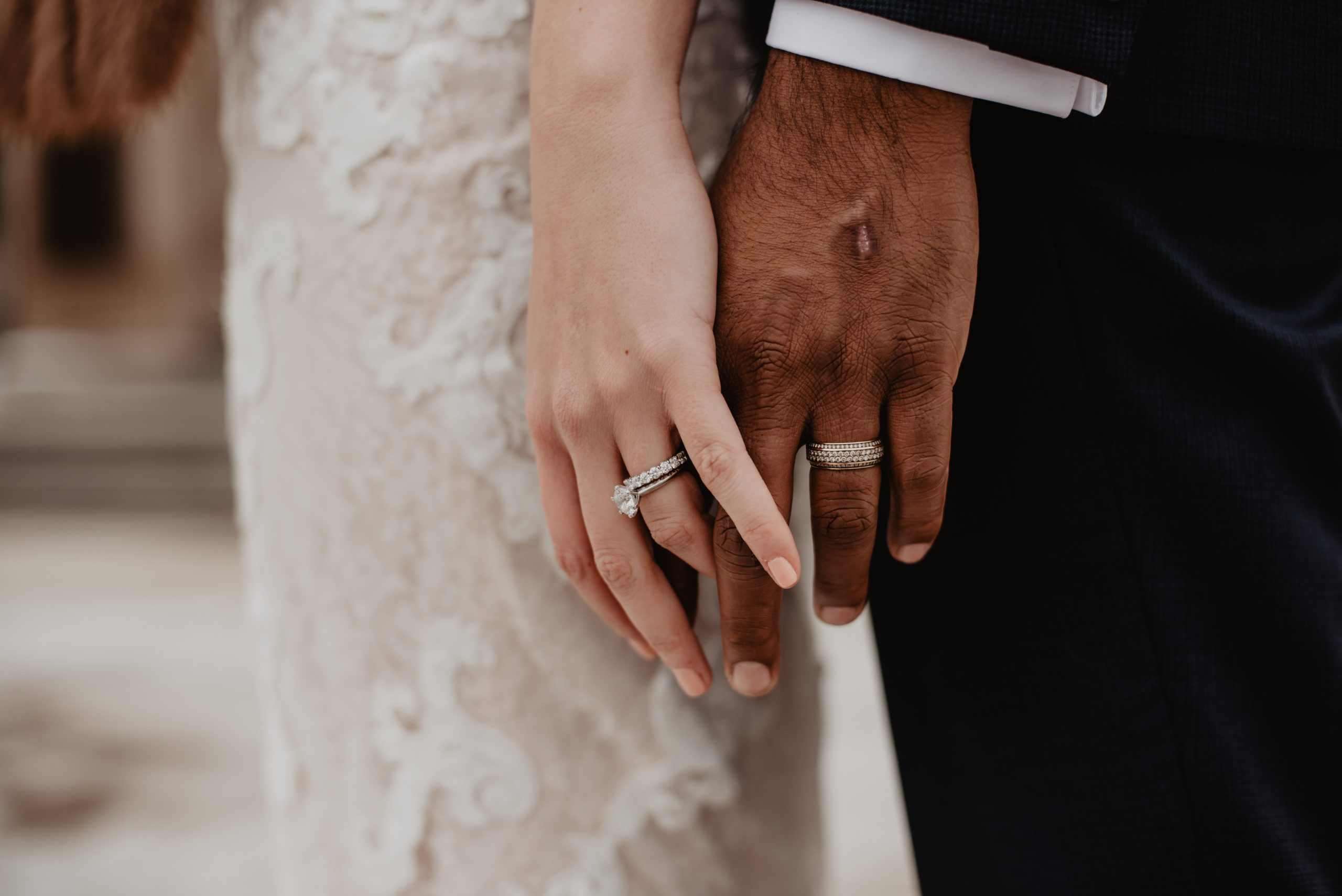 two-persons-wearing-silver-colored-rings-3585798