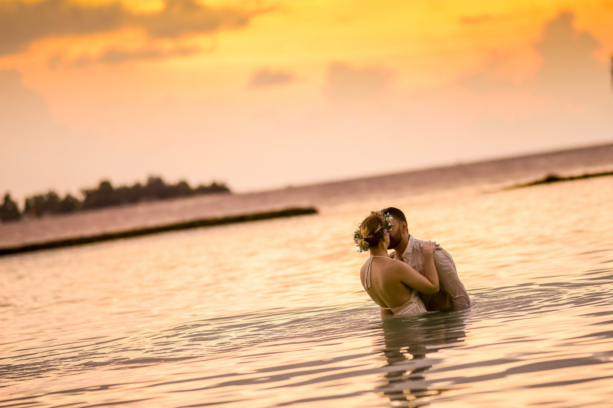woman-and-man-kissing-in-body-of-water-1024991