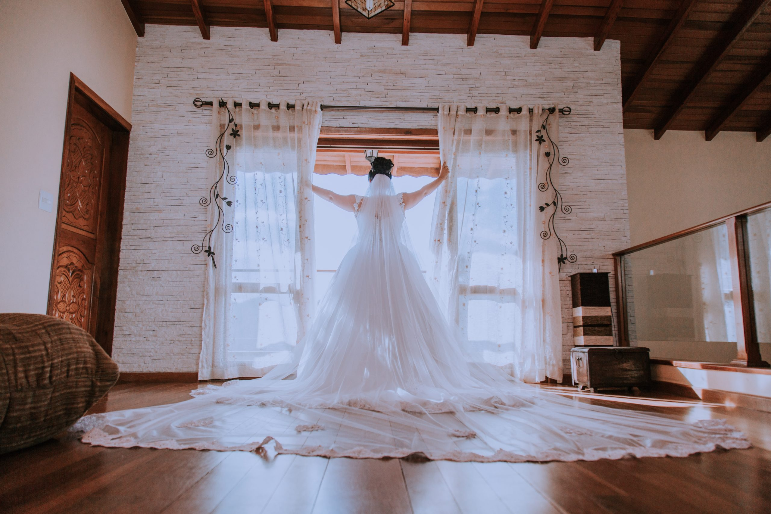 woman-in-white-wedding-gown-by-the-window-2046681